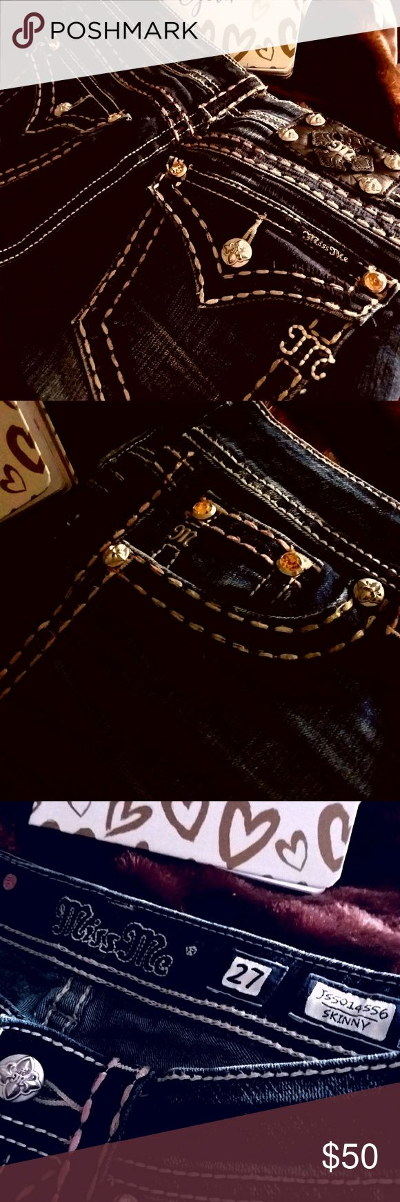 🌟Miss Me BRAND NEW GOLDEN GEMS JEANS 🌟SZ 27 Miss Me BRAND NEW !!!!!   GOLDEN GEMS JEANS DARK DENIM WITH Miss Me's IDEAL AMOUNT OF LIGHT DISTRESS CREASES BELOW THE FRONT POCKETS & UPPER THIGH'S ON FRONT & JUST THEIR HINT OF DISTRESS RIGHT AT THE REAR UNDER THE BACK ORNATE GOLD GEMS ON POCKETS !!!!  THESE ARE THE SKINNY STYLE BUT, NOT AS SKINNY AS SOME STYLES !!!  THESE ARE FROM MY COLLECTION OF MY BRAND NEW JEANS THAT I HAVE BOXES OF WANTING TO PART WITH NOW AS I HAVE TOO MANY FOR JUST ME…