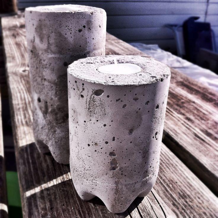 Concrete DIY candle holders pour concrete into empty soda bottle, let dry, remove bottle et voilà.