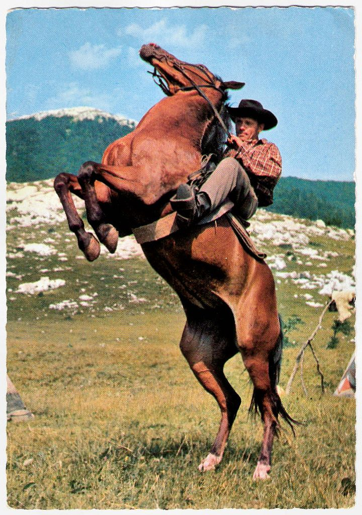 https://flic.kr/p/SDQdS5 | Scene from Winnetou II. Teil (1964) | German postcard, no. R 18. Photo: publicity still for Winnetou 2. Teil/Winnetou: The Red Gentleman (Harald Reinl, 1964). Caption: Forrester sorgt für Unfrieden. Er überfällt mit seiner Bande einen Siedlertreck und hinterlässt falsche Spuren, um die Indianer in den Verdacht dieser Untat zu bringen. (Forrester is a source of dissatisfaction. He crosses a settlement with his gang, leaving behind bad traces to bring the Indians…