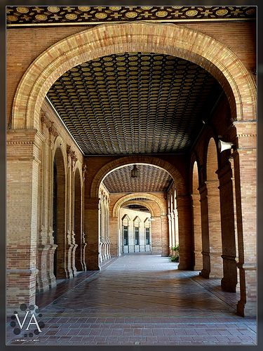 ■ Plaza de España (Seville, Spain).  Taken handheld with a Panasonic Lumix TZ7 (ZS3) under blazing sun ( 42 mm, F3.7, 1/125 s,, ISO 125 ). Hot sunlight was overwhelming and I wanted to try this shadowy arch. The 10 Mpixel full-size pic has incredible Barcelona Airport Private Arrival Transfer Excursions in Barcelona Holidays in Barcelona Sightseeing tours, airport transfers, taxi, interpreter and your personal guide in Bar