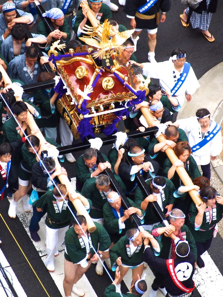 The people who carry the Mikoshi (portable shrine)  on their shoulder in summer festival.