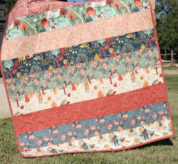 This modern baby girl quilt was created using Teagan Whites newest fabric line Acorn Trail for Birch Organic Fabrics which is 100% GOTS