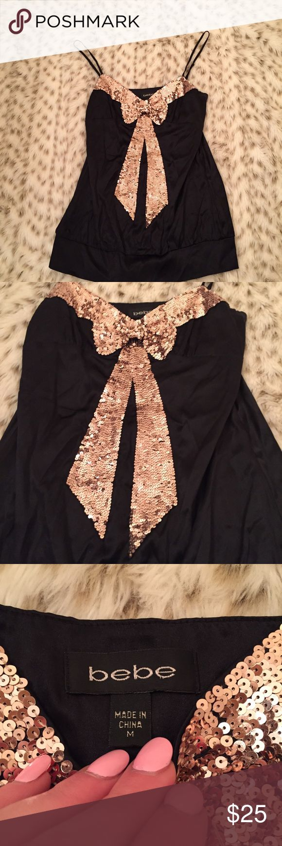 Bebe Silk Sequin Bow Tank Top Bebe size medium black silk tank top with rose gold sequin bow! Gorgeous and so silky soft! Silk blend with spandex! Worn only a handful of times! Excellent used condition! bebe Tops Tank Tops