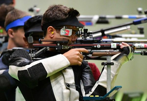 Germany's Julian Justus competes during the men's 10m Air Rifle at the Olympic Shooting Centre in Rio de Janeiro on August 8, 2016, during the Rio 2016 Olympic Games.  / AFP / PASCAL GUYOT