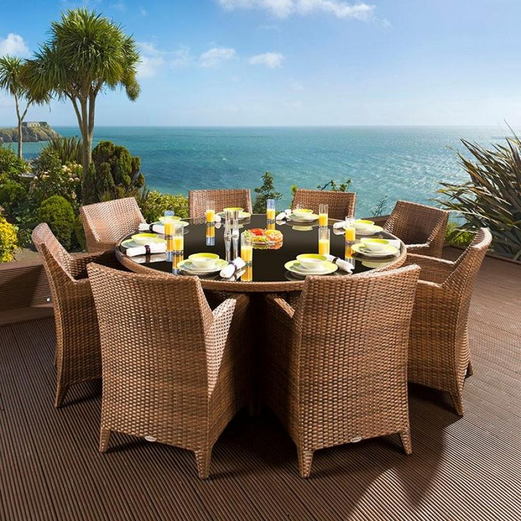 The dining set consists of a round brown glass topped table and 8 wide, comfortable armchairs/carvers. Made from fully weatherproof PE rattan, hand woven over a rust resistant frame. This maintenance free table is designed to be left outside all year round without the need for covering. The frame is made from 1.2 mm thick aluminium tube with grey powder coating applied after welding. It is UV light resistant to ensure that the coloured rattan does not fade in the sunlight.