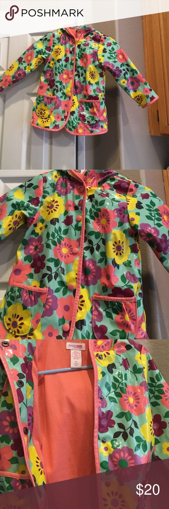 Kids Rain Jacket Cute flower design. Water proof plastic. Snap button up with hood. Wore two short times. Genuine Kid Jackets & Coats Raincoats