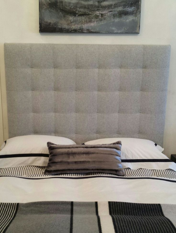 Blind Buttoned heaboard by PAD UK, upholstered in wool with double stitching detail.