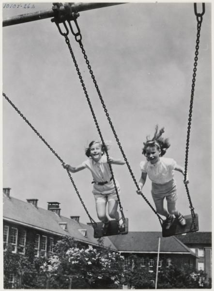 Standing and swinging ..and the ground was concrete! No health and safety in those days - we were tough!