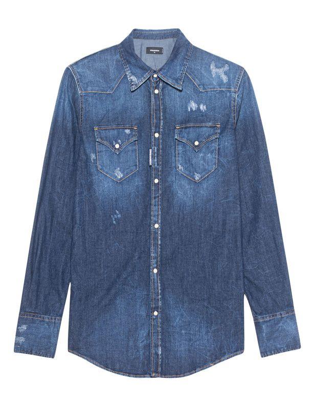 Jeanshemd Das schmal geschnittene Jeanshemd ist aus einem stretchigen blauen Baumwoll-Denim gefertigt und kommt mit zwei Brusttaschen, Druckknöpfen und coolen Destroyed-Elementen.  Jeanshemden sind absolute Must-Haves in jedem Kleiderschrank!