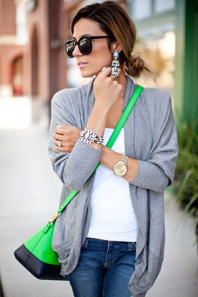 Not a statement necklace, but statement bracelet and earrings set that look great with the gray cardigan, jeans, and white tee. Pop of green on the purse .
