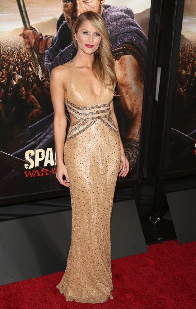 Ellen Hollman on the red carpet in a  gold embellished gown.