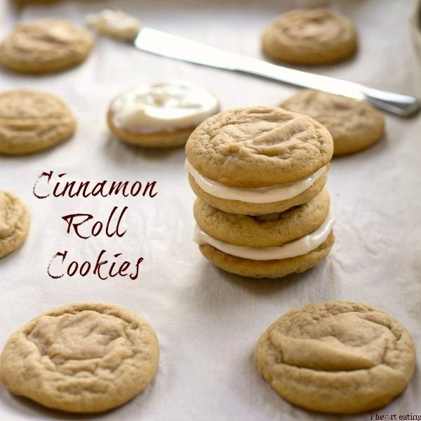Cinnamon Roll Cookies   Soft, thick cinnamon cookies spread with a tangy cream cheese frosting.