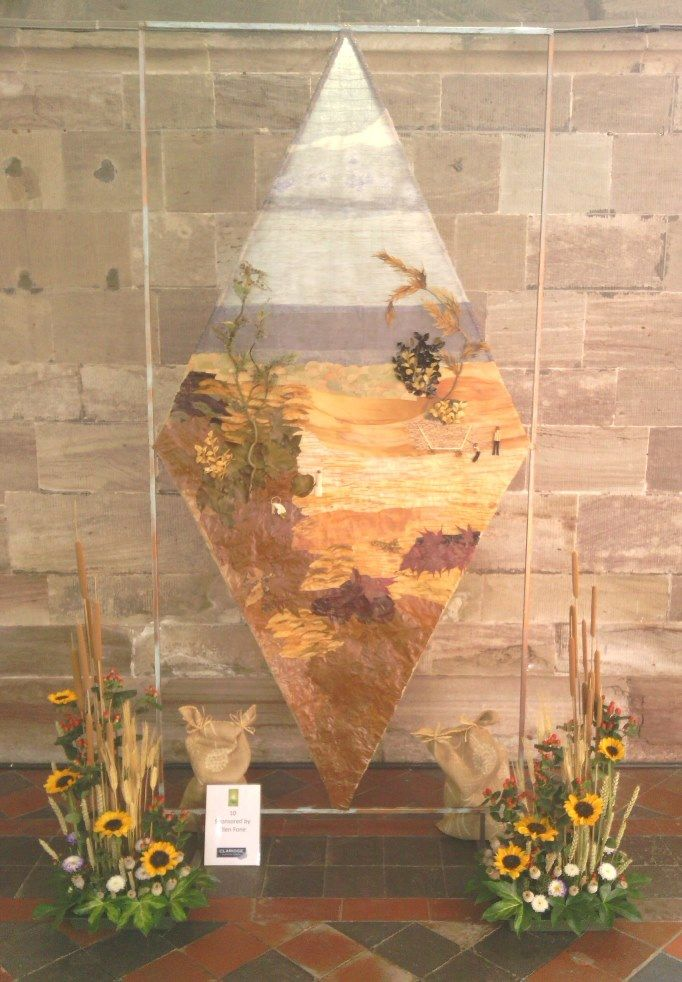 A floral arrangement based on work by artists featured in a book by the Dean of Hereford 'Saints & Sinners of the Marches'
