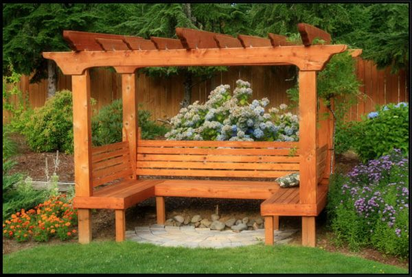 Lovely arbor with a built-in bench. This isn't exactly the kind of bench I had in mind for the southwest corner of our back yard, but I just might change my mind!