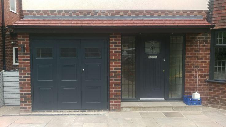 Anthracite powder coated off center split side hinged garage door complete with windows installed by Avemoor Garage Doors
