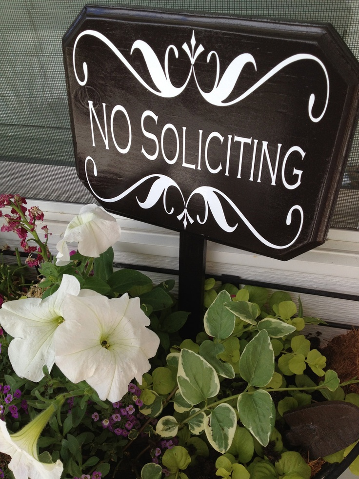 No Soliciting Sign. Love the idea of putting it in a planter by the front door.  Could make one myself.