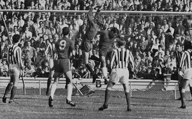 29th August 1964. Sunderland goalkeeper Jim Montgomery catches the ball under pressure from Chelsea striker Barry Bridges, at Stamford Bridge.