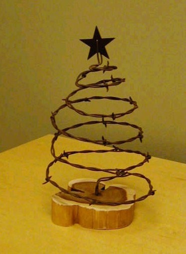 Rustic Barb-Wire X'Mas Tree on Cedar base $15.00 plus shipping, to order contact woodcrafterswisdom@gmail.com