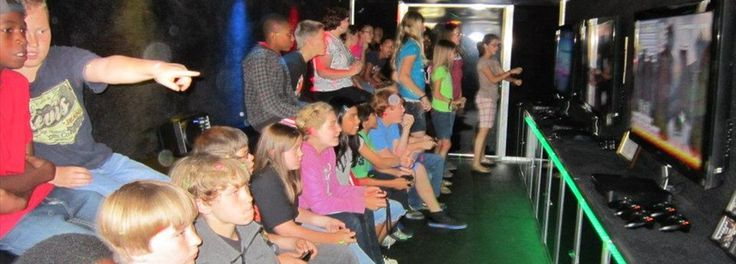 Our luxury, limo-style theater on wheels features 4 widescreen high-definition TVs, surround sound and multiplayer gaming heaven! 16 can play at the same time with room for 8 more friends on the second row of stadium seating! We have all the latest titles from Xbox 360, Wii, and PlayStation 3.
