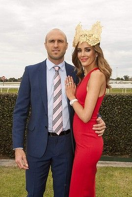 Chris and Rebecca Judd attend the Caulfield Cup Carnival day at Caulfield Racecourse on October 18, 2014 in Melbourne, Australia.