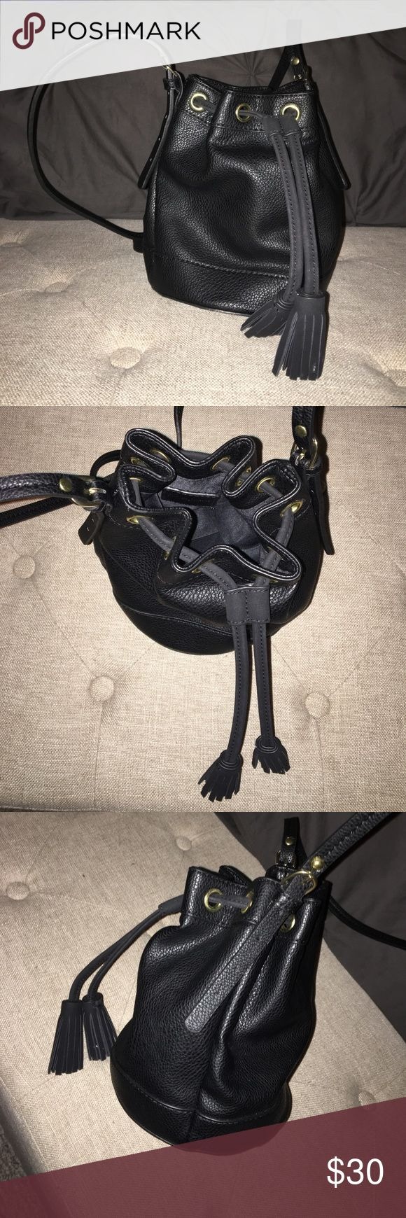 Neiman Marcus Last Call Side Tassel Bucket Bag (s) Black Neiman Marcus (Last Call) bucket bag with tassel drawstring. Adjustable strap. One pocket inside. Never used and new. Small size. Neiman Marcus Bags Shoulder Bags