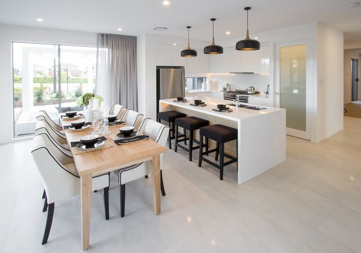 Open plan living, kitchen and dining in layers of neutrals.