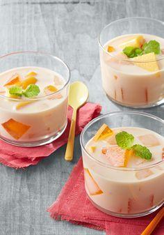 Cremoso flan de mango de dos leches- Este lujoso postre de flan de mango de dos…