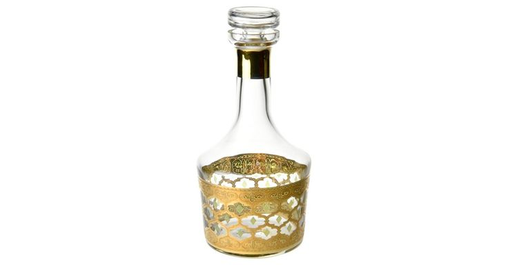 Midcentury decanter encrusted with an intricate gold pattern and raised green enamel detail.  Approximately 39 ounce capacity. No maker's mark.
