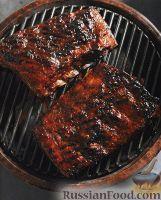 Фото к рецепту: Свиные ребрышки, жаренные на гриле