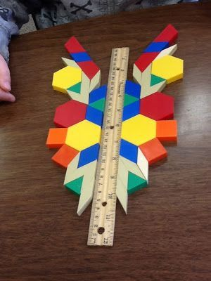 Geometry Unit and Symmetry Activity.  Great visual and hands on way for your students with special learning needs to practice symmetry.  A fun and age appropriate center even for secondary grades. Get all the directions at:  http://teaching-in-oz.blogspot.com/2012/10/geometry-unit-and-symmetry-activity.html