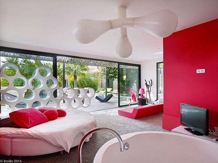 Hotels & Resorts:Interesting Modern Villa With Red Interior Design Along With Bathtub Plus Arch Faucet Plus Sweet Pendant Light And Sofa Bed Plus Red Cushions And Television And Red Wall Plus Red Sofa Bed In Living Space And Carpet Floor Outstanding Cozy Villa With Nicely Colorful and Lovely Landscaped in France