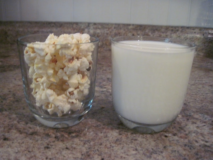 """FUN SCIENCE EXPERIMENT!  We are calling the  """"Farmer Boy Experiment"""".  In chap. 3 of the book Farmer Boy it says: """"You can fill a glass full to the brim with milk, and fill another glass of the same size brim full of popcorn, and then you can put all the popcorn kernel by kernel in to the milk, and the milk will not run over.  You cannot do this with bread.  Popcorn and milk are the only two things that will go into the same place.""""  We tried it and it works!"""