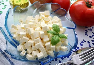 Goat Cheese lower fat & calories than regular cow's milk cheeses. Plus other health benefits to eating Goat's cheese.