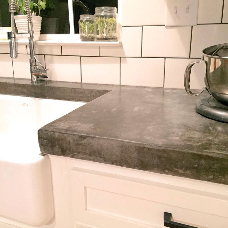 Thick concrete countertops and subway tiles to make a statement