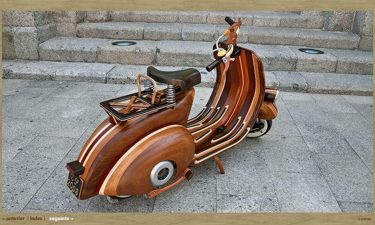 A handmade, bent-plywood body for a Vespa.  Gracious.