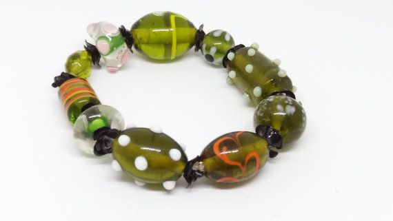 A pretty bracelet made up of lots of different shaped beads, threaded onto clear beading elastic. Medium to large size wrist.  Your bracelet