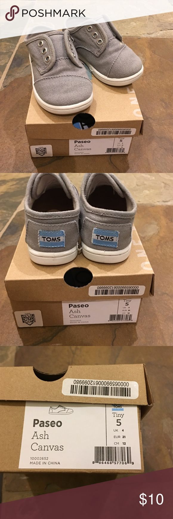 Baby boys gray Toms Paseo Size 5 Baby boys gray Toms Paseo Size 5. These are such great shoes for just walking. Velcros on both sides for easy on and off, but they actually stay on too! We've had many pairs of these. Really great condition! TOMS Shoes Sneakers