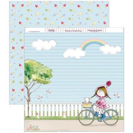Papel scrap con una niña en bici y un arcoiris, y estampado de helados por detrás #scrap #conideade #manualidades