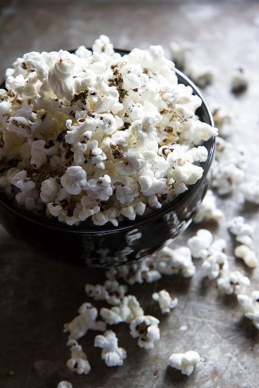 Flavored popcorn is so easy to make! Coat air-popped corn with olive oil then sprinkle your favorite seasonings like oregano or rosemary.
