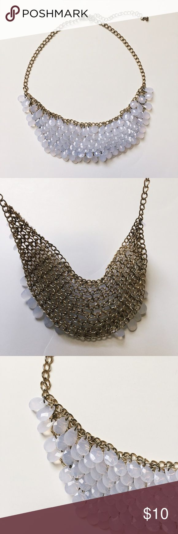 Clear Teardrop Bib Necklace Excellent condition! Gold tone chain with plastic teardrops. All intact. I bought this secondhand and it had no tags so I have no idea what the brand is!! 😓 Listed as jcrew for exposure only. Works with a variety of necklines, from crew to v-neck. Listing price is my lowest, please bundle for a discount, thanks! 😘 J. Crew Jewelry Necklaces