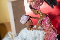 Nigerian Barbie bride crowning her groom during their  engagement party.