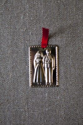Bride & Groom Wedding Milagros, or 'Miracles', found in many areas of Latin America, are used by the people to petition saints for help or protection. Use these  charms to attract love and then give thanks once you have found it. Embossed nickel threaded with red ribbon.