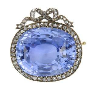 LOT:210 | AUGUST HOLLMING - a silver and gold sapphire and diamond brooch, circa 1905.