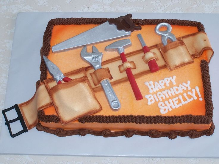"""Tool Belt Cake The """"tools"""" are chocolate and the """"tool belt"""" is fondant. I airbrushed """"Home Depot"""" orange."""