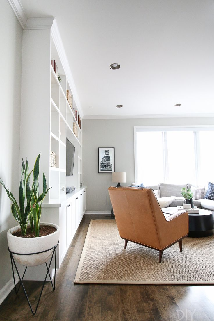 This living room space works well with a leather chair opposite the gray sectional.
