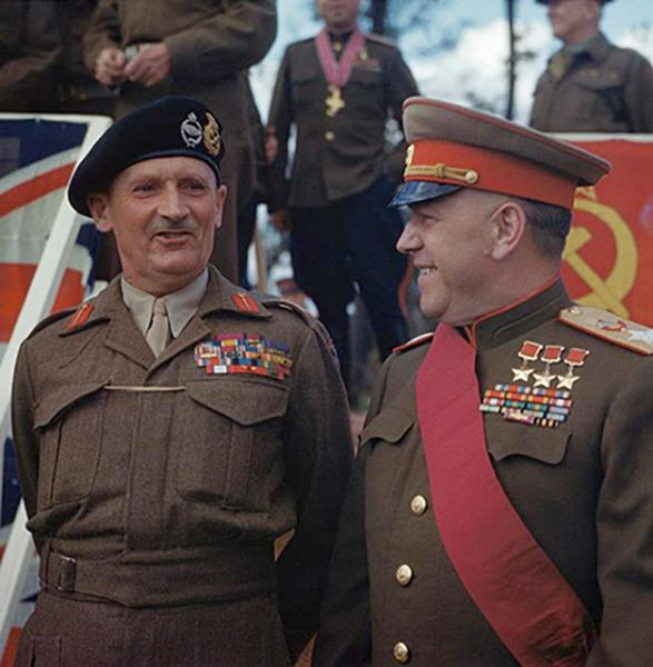 "12 Jul 45: The British honor Soviet General Georgy Zhukov in a ceremony at the Brandenburg Gate for having planted the flag of victory over Berlin. Zhukov and three other Soviet generals are presented with the sash of the Knight Grand Cross of The Most Honourable Order of the Bath by Field Marshal Sir Bernard Montgomery. These Russians are now entitled to wear ""Sir"" in front of their names. More: http://scanningwwii.com/a?d=0712&s=450712 #WWII"