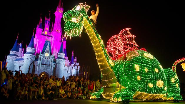The Pete's Dragon Elliott float sparkling with lights in the Main Street Electrical Parade