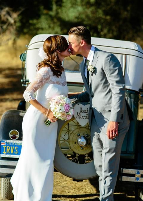 Stylish with a vintage nod. Bride married in Audrey's lace and crepe sheath silhouette, #Wedding dress by Amy Kuschel. #Photography: Claire Dobson Photography.