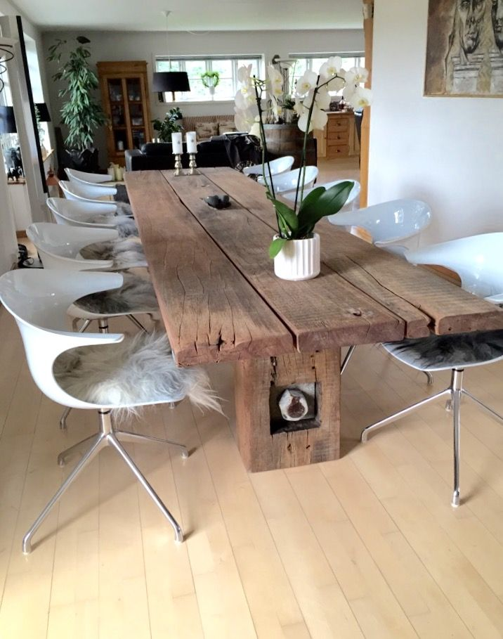 A beautiful dining room furnished with a THORS Gaia rustic table and Loop chairs www.thors-design.dk