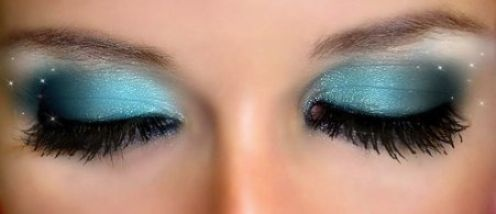 Dark Outer to light blue inner with light speckles and dark eye lashes..